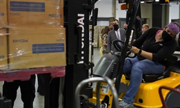 Oklahoma Gov. Kevin Stitt, rear, watches as a forklift operator loads boxes of PPE for Edmond Public Schools at the Central Oklahoma PPE distribution warehouse on Aug. 18, 2020, in Oklahoma City.