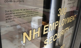 A note on a locked door at the New Hampshire Employee Security center, which handles unemployment claims, gives directions to those in need in Manchester, N.H., Thursday, April 16, 2020.