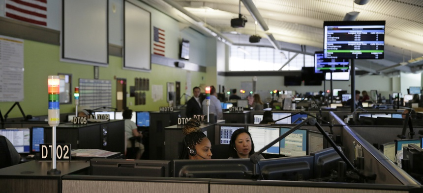 In this photo taken Aug. 2, 2019, is the 911 call center at the San Francisco Department of Emergency Management in San Francisco.