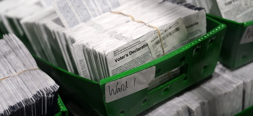 Ballots for the 2020 General Election in the United States are seen at Philadelphia's mail-in ballot sorting and counting center on Oct. 26, 2020, in Philadelphia.