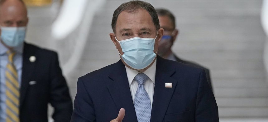 Utah Gov. Gary Herbert gives a thumbs up as he walks through the Capitol rotunda to a Covid-19 briefing Monday, Nov. 9, 2020, a day after issuing a statewide mask mandate.