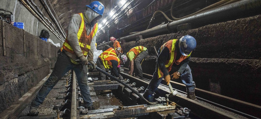 This June 15, 2019 photo provided by the Metropolitan Transportation Authority shows workers during the L Project subway tunnel rehabilitation, in New York.