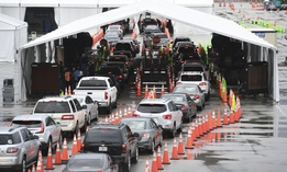 Cars wait in line at the Coronavirus (COVID-19) drive in testing site, set up in the parking lot of Hard Rock Stadium as Florida reported more than 5,838 new cases of COVID-19 on November 12, 2020 in Miami Gardens, Florida.
