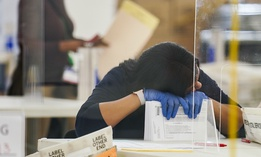 Polling workers inspect and count absentee ballots, Tuesday, Nov. 10, 2020, in New York.