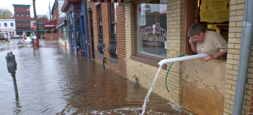 Sveinn Storm pumps water out of his flooded Storm Bros. Ice Cream Factory store in downtown Annapolis, Md. on Oct. 30, 2012, in the aftermath of Hurricane Sandy.