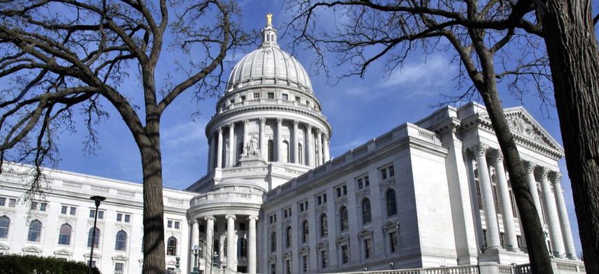 The Wisconsin state capital building in Madison. The dispute over how to respond to COVID-19 is expected to spill into next year in Wisconsin.
