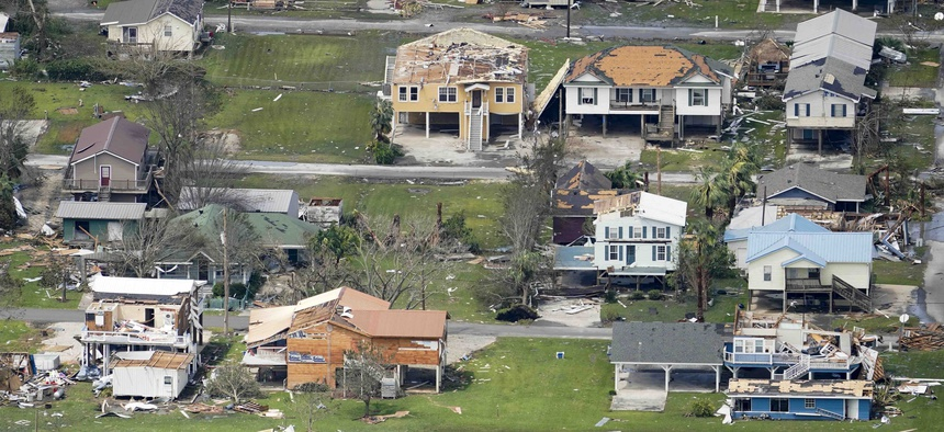 Buildings and homes are damaged in the aftermath of Hurricane Laura Thursday, Aug. 27, 2020, near Lake Charles, La.