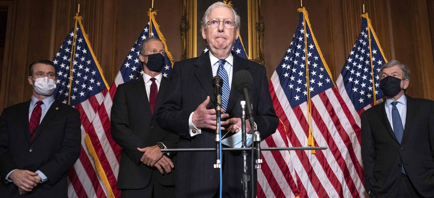 Senate Majority Leader Mitch McConnell of Kentucky, speaks to the media after the Republican's weekly Senate luncheon, Tuesday, Dec. 8, 2020 at the Capitol in Washington.