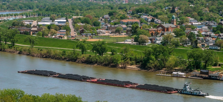 Coal barges are pushed by a boat on the Ohio River.