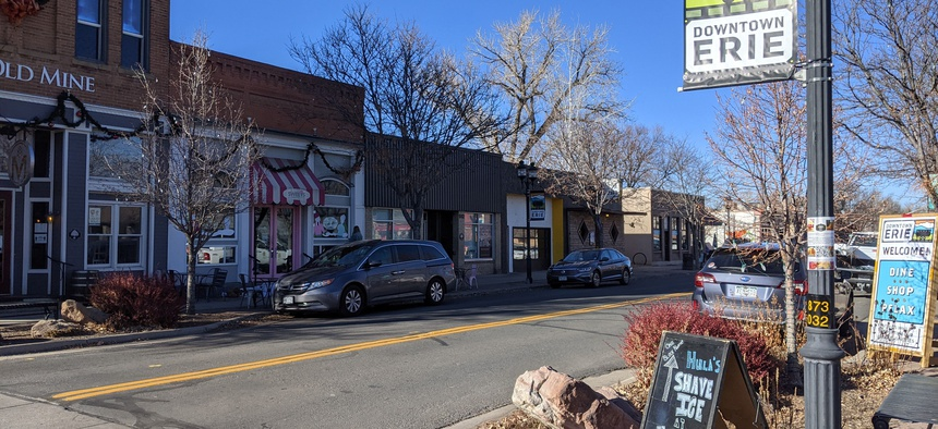The town of Erie, Colorado, straddles two counties with opposite views on how to approach COVID-19.