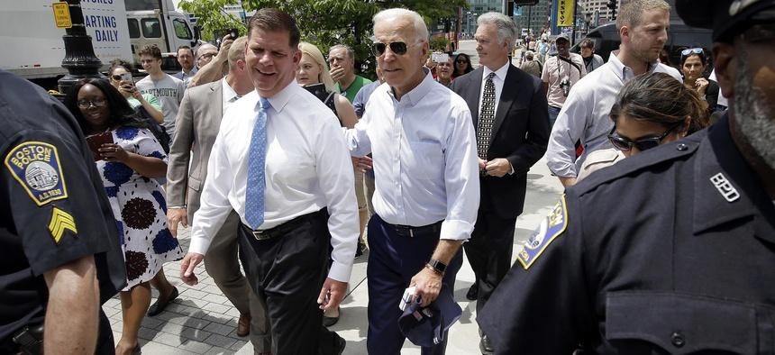President-elect Joe Biden walks with Boston Mayor Marty Walsh, left, on June 5, 2019, in downtown Boston.