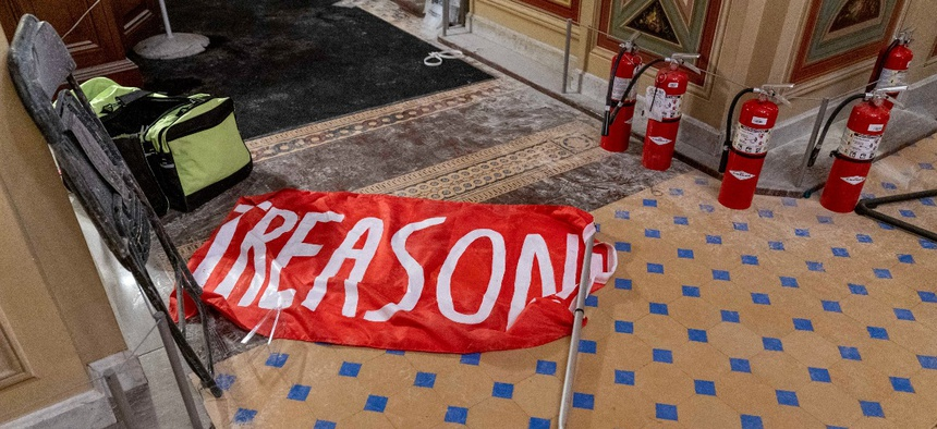"A flag that reads ""Treason"" is visible on the ground in the early morning hours of Thursday, Jan. 7, 2021."