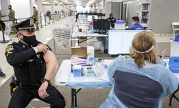 Sergeant Michael Zarro, of the Mount Olive, NJ, Police Department, rolls up his sleeve to receive a COVID-19 vaccination at one of the state's two vaccine megasites in Morris County, NJ on Friday, Jan. 8, 2021.