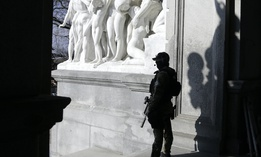 A Capitol police officer stands at the front entrance of the Pennsylvania Capitol building Tuesday Jan. 12, 2021, in Harrisburg, Pa.