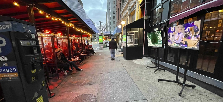 Patrons watch sports outside in the frigid January 2021 weather as dining is restricted to 'outdoors onl'y during the coronavirus pandemic in New York City.