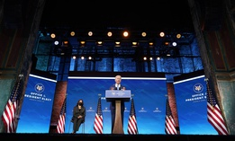 President-elect Joe Biden speaks about the COVID-19 pandemic during an event at The Queen theater, Thursday, Jan. 14, 2021, in Wilmington, Del., as Vice President-elect Kamala Harris listens.
