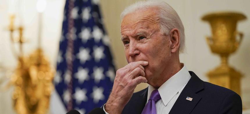 President Joe Biden pauses as he speaks about the coronavirus, accompanied by Vice President Kamala Harris, in the State Dinning Room of the White House, Thursday, Jan. 21, 2021, in Washington.