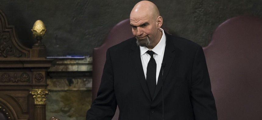 Lt. Gov. John Fetterman gavels in a joint session of the Pennsylvania House and Senate before Democratic Gov. Tom Wolf delivers his budget address for the 2019-20 fiscal year, Harrisburg, Pa., Tuesday, Feb. 5, 2019.