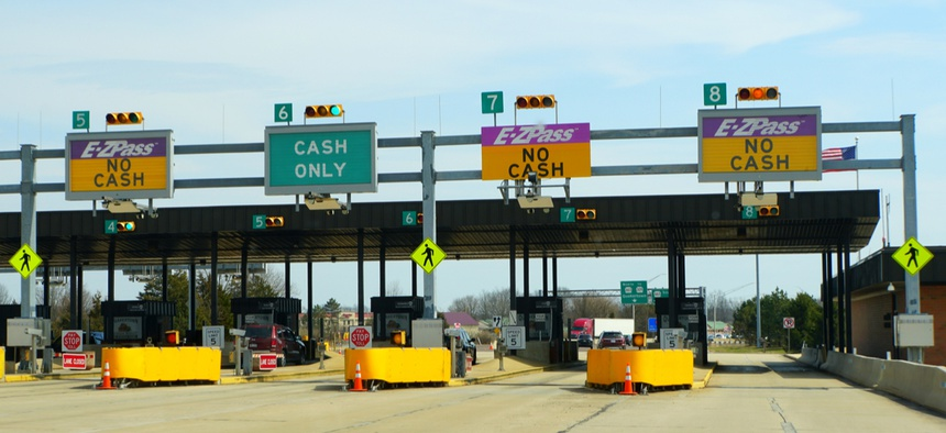 E-ZPass and cash only lanes at a toll exit in Pennsylvania. Technology can pave the way for cashless tolling.