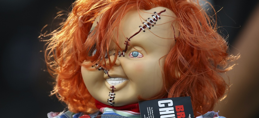 A Chucky doll is held by a fan during the first half of an NFL football game between the Oakland Raiders and the Los Angeles Rams in Oakland, Calif., Monday, Sept. 10, 2018.