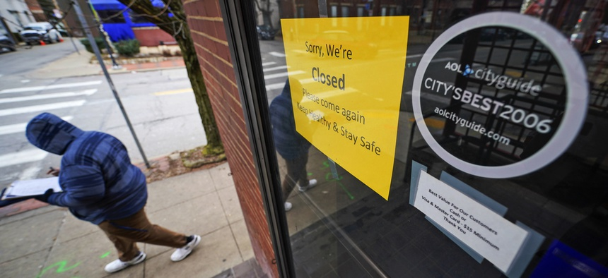 A sign hangs on the door of the Union Grill, temporarily closed due to COVID-19, in the Oakland neighborhood of Pittsburgh on Thursday, Jan. 28, 2021.