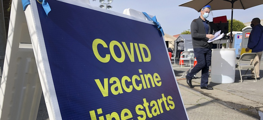 A sign is shown at a COVID-19 vaccine site in the Bayview neighborhood of San Francisco, Monday, Feb. 8, 2021.