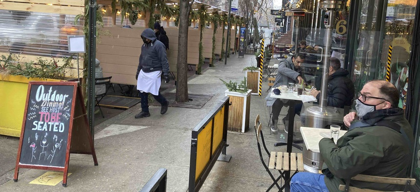 Diners brave freezing temperatures on Jan. 26, 2021 at Veselka restaurant in New York City during the coronavirus pandemic while indoor dining is still prohibited.