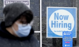 In this Saturday, Feb. 6, 2021 file photo, a now hiring sign is displayed at a CD One Price Cleaners in Schaumburg, Ill.