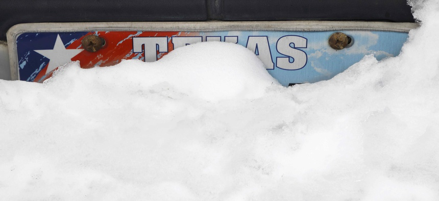Snow begins to melt on a car in Euless, Texas, Thursday, Feb. 18, 2021.