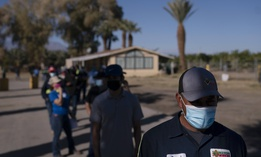 Farm workers wait in line to receive the Pfizer-BioNTech COVID-19 vaccine at Tudor Ranch in Mecca, Calif., Thursday, Jan. 21, 2021.