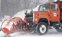 A snowplow clears the freeway during a snowstorm in Minneapolis on Saturday, Dec. 11, 2010.