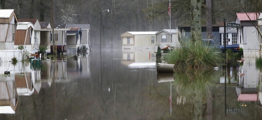 Standing floodwater from the Pearl River still surrounds a number of mobile homes in the back portion of the Harbor Pines community in Ridgeland, Miss., Tuesday, Feb. 18, 2020.