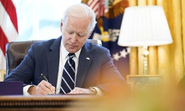 President Joe Biden signs the American Rescue Plan, a coronavirus relief package, in the Oval Office of the White House