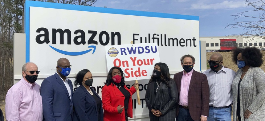Democratic members of Congress join representatives of the Retail, Wholesale and Department Store Union gather outside an Amazon fulfillment center in Bessemer, Ala.