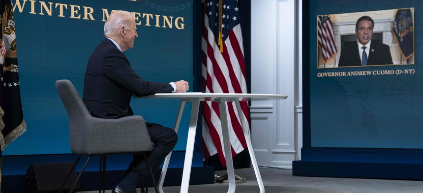 In this Feb. 25, 2021, photo, President Joe Biden listens as Gov. Andrew Cuomo, D-N.Y., speaks during a virtual meeting of the National Governors Association, in the South Court Auditorium on the White House campus in Washington.