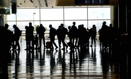 Travelers walk through the Salt Lake City International Airport Wednesday, March 17, 2021, in Salt Lake City.