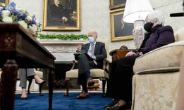 President Joe Biden, accompanied by Treasury Secretary Janet Yellen, right, speaks as he gets his weekly economic briefing in the Oval Office of the White House, Friday, April 9, 2021, in Washington.